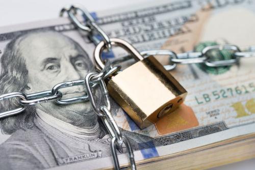 Padlock on Money Signifying Legacy Trusts