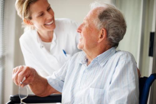 Man in Wheelchair with Nurse