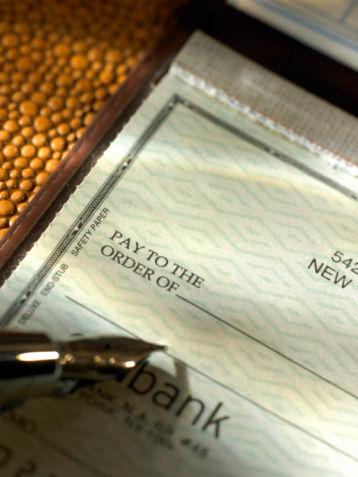 Checkbook and fountain pen