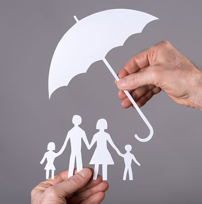 Family of Paper Dolls Under Umbrella - How Much Life Insurance Do You Need?