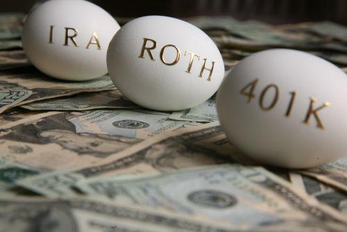Nest Eggs: IRA, Roth, 401k written in gold on eggs