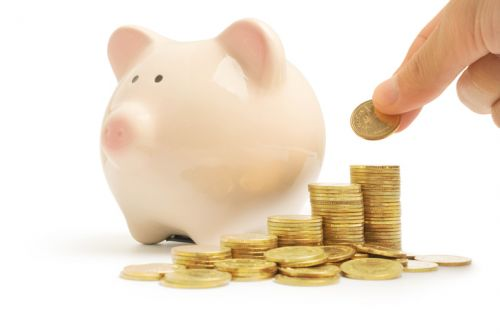Piggy Bank and Coins Representing Estate Tax Exemption Savings