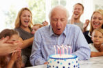 Longevity Planning - Grandfather Blowing Out Birthday Candles