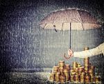 Asset Protection - Umbrella Protecting Money from Rain